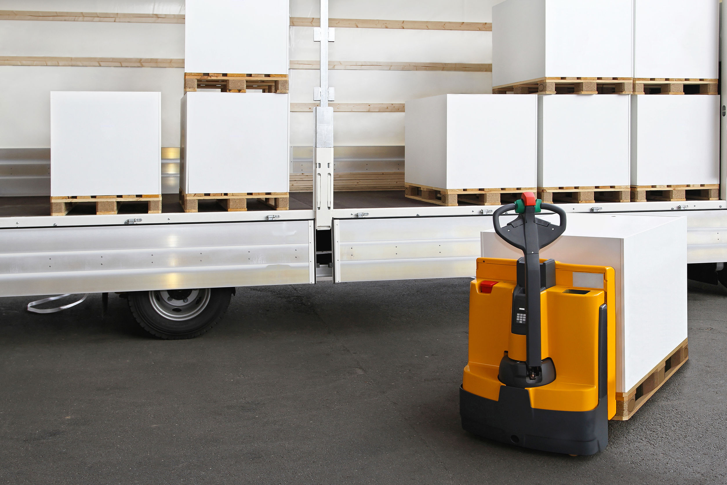 Forklift loading pallets with paper in truck